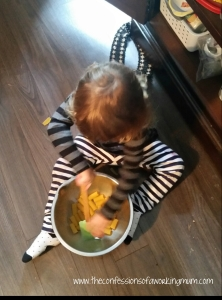 My daughter stirring the pasta. Keeps her occupied, but she is still helping!